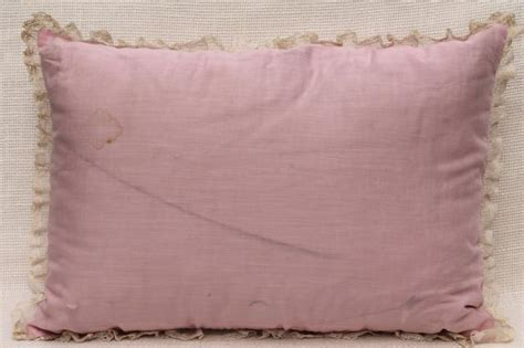 bed with a lot of pillows 1920s 30s vintage pink white lace trimmed embroidered