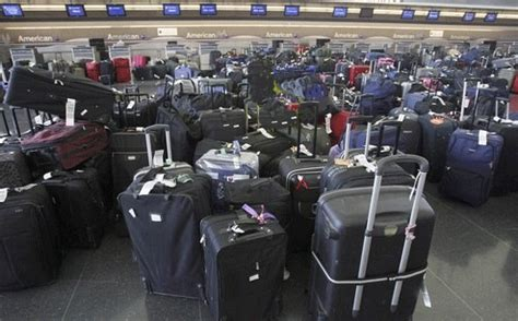 baggage laid out at airline luggage counter after flight lost luggage delayed and damaged luggage information