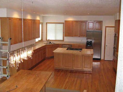 light oak cabinets with dark wood floors   DeducTour.com