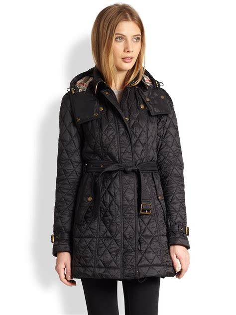 burberry brit belted quilted jacket in black lyst