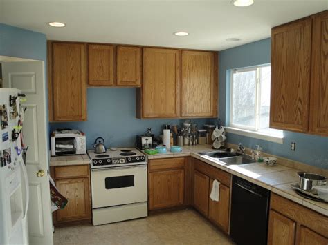 blue kitchen with oak cabinets mr homeowner tear down this wall kitchen blue