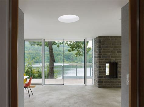 Lukis Kaca Mininalis lake house above rur reservoir in germany is minimalist