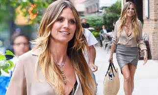 heidi klum surrounds herself with five real life clones at her heidi klum shows off her famous gams in grey leather mini