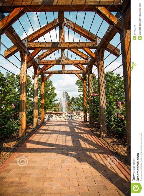 Garden Arbor Plans Brick Walkway Through Rose Arbor Toward Fountain Stock