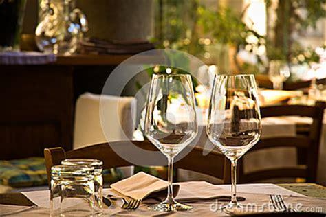 wine glasses  table setting  restaurant stock images