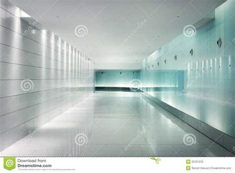Underground Interior Design by Back Lighted Glass Walls In An Underground Futuristic
