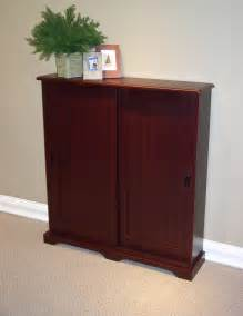 heirloom storage cabinet with 4 shelves cherry cherry wood dvd storage cabinet manicinthecity