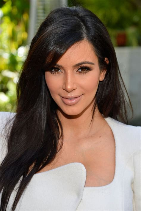 pic of black women side swept bangs and bun hairstyle kim kardashian sexy long black straight hairstyle with