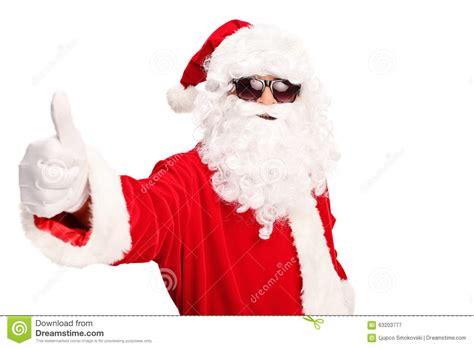 black santa up cool santa with sunglasses giving a thumb up stock photo