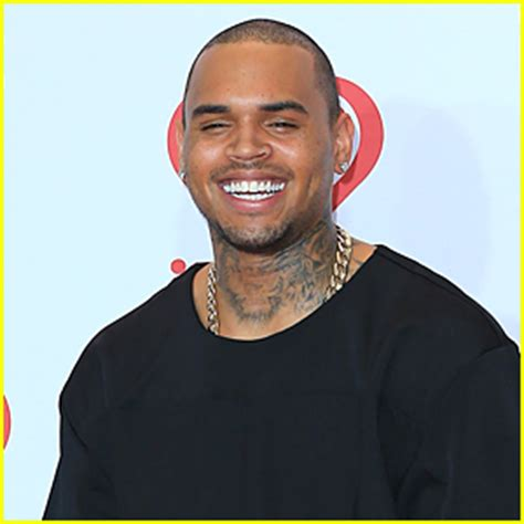 chris brown calls adrienne bailon quot trout b ch quot chris brown slams the real hosts adrienne bailon