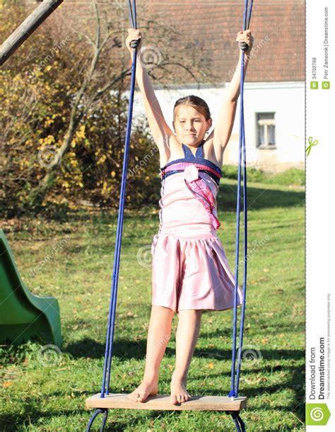 kid on swing kid girl on swing royalty free stock photos image