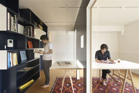 Moving Interior Walls by Sliding Walls Turn Tiny Apartment Into Home Office And