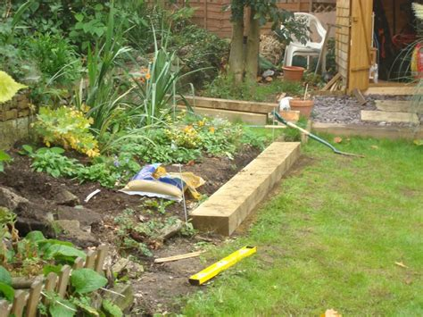 Laying Garden Sleepers by Do Or Diy Garden Landscaping With Railway Sleepers