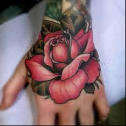 flower hand tattoo rose tattoo with red petals