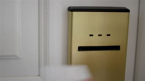 open the door with card entry into the hotel room stock