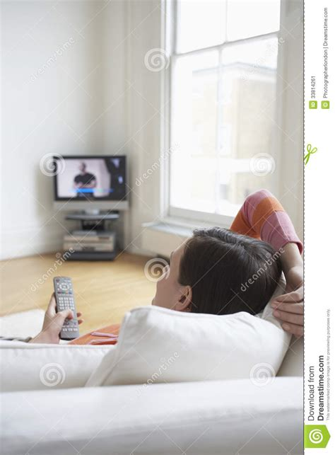 watch tv couch woman on couch watching tv stock image image 33814261