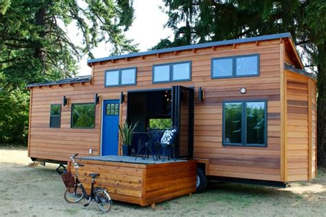 tiny heirloom s larger luxury tiny house on wheels tiny house talk tiny luxury tv show on hgtv