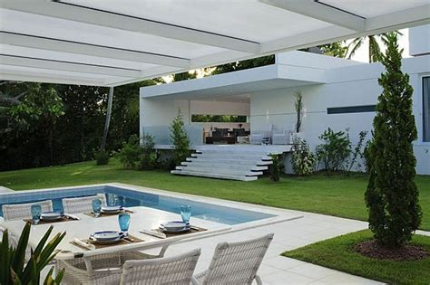 modern home architect cool swimming pool on the yard of contemporary open house with