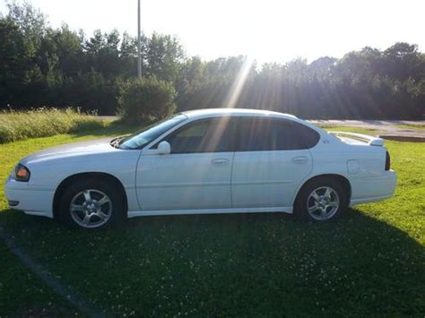 how make cars 2005 chevrolet impala parental controls sell used white 2005 chevy impala ls only 47 097 miles in gulliver michigan united