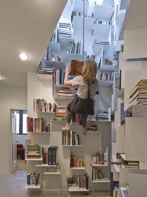 incredible home bookcase climbs 40 feet of interior walls