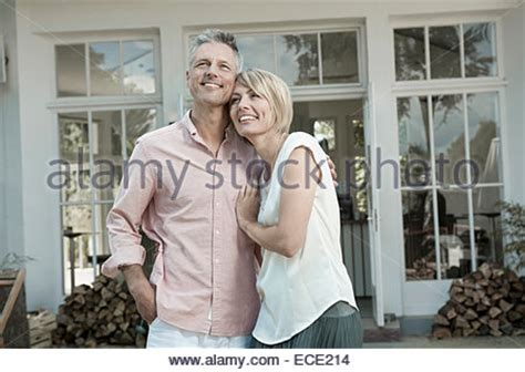 middle age chic beautiful blonde middle aged woman listening to music on