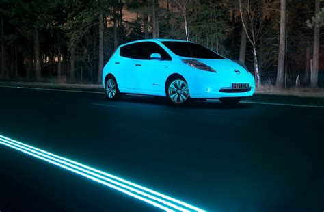 glow in the paint nissan phosphorescent nissan leaf on glowing highway looks like a