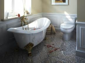 small bathroom with brick flooring also black
