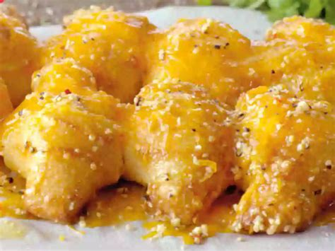 papa johns introduces  garlic cheddar knots chew boom