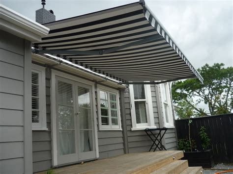 house awnings lateral arm awnings door awnings