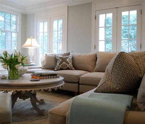 pretty wall color with tan couch f a m i l y r o o m aqua and grey family room traditional family room dc