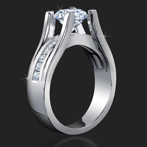 Wide Band Floating Diamond Tension Mounted for Maximum Sparkle with Invisible Channel Set