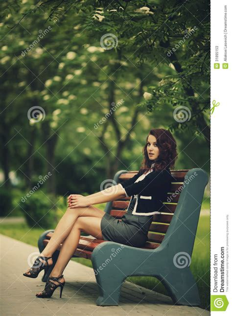 sitting on bench young beautiful girl sitting on bench stock photos image