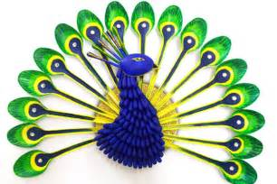 This stunning peacock is made from plastic spoons and cotton swabs it