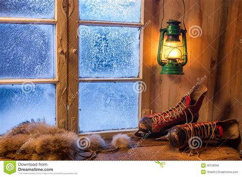 House Of Warmth by Warm Wooden House In The Winter Evening Royalty Free Stock
