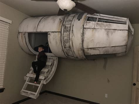 millennium falcon bed dad builds his son a star wars millennium falcon bed that hangs from the ceiling