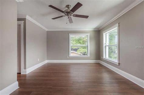 grey walls white trim warm brown floors
