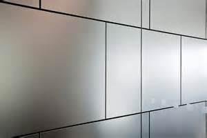 Levele wall cladding system with float panels in stainless steel with
