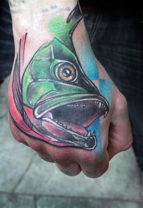 tattoo hand fish colorful fish hand tattoo