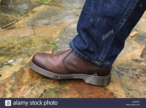 brown leather doc martens boots and blue fashion