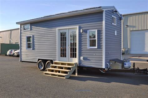 tiny house on wheels companies tiny house building company s solar powered cottage on wheels