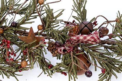 primitive rusty tin bells and artificial pine garland