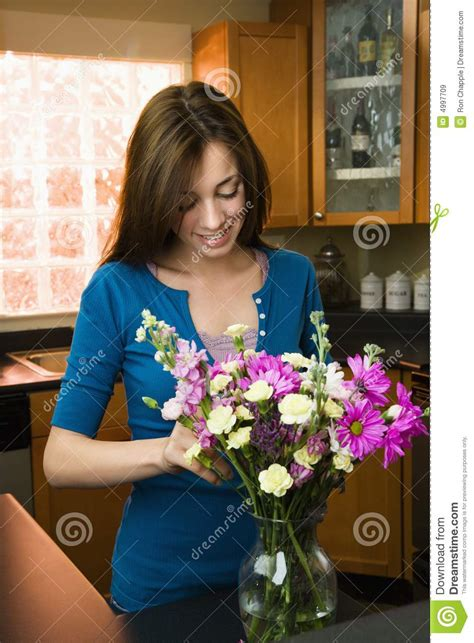 putting flowers in vase royalty free stock images