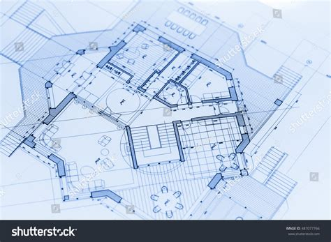 architect blueprints architects workspace with rolled construction plans and