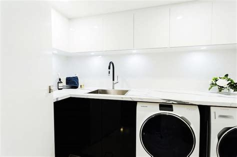 white laundry room cabinets shelving washer and dryer cottage laundry room
