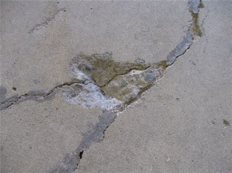 How To Repair Garage Floor Concrete by Dealing With Winter S Damage To Your Garage Floor Www