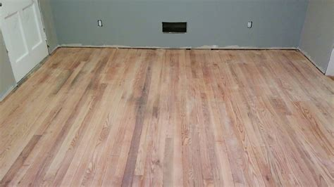flooring   How much sanding do I need to do to refinish a