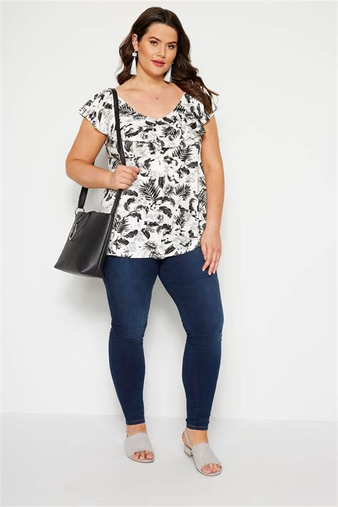 limited out 3 days in row limited collection black white tropical cross back top