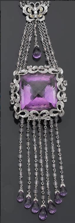 an amethyst and gem set necklace featuring a