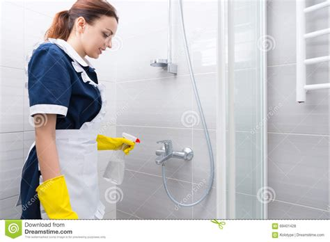 how to clean hotel bathroom hotel housekeeper cleaning a bathroom stock photo image