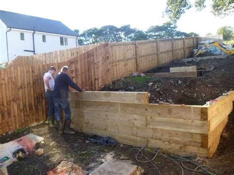 Retaining Wall With Sleepers by New Pine Railway Sleeper Retaining Wall